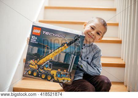 Uzhhorod, Ukraine - March 17, 2021: Happy Boy Holding Box Of Lego Technic