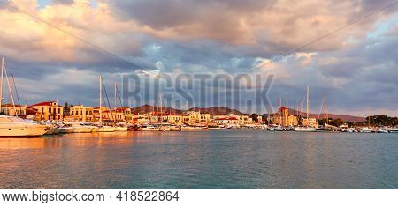 Aegina town at sunset, Panoramic view of seafront and harbour, Aegina Island, Greece