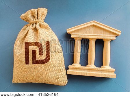 Israeli Shekel Money Bag And Government Building. Business And Finance Concept. Deposit, Loan And In