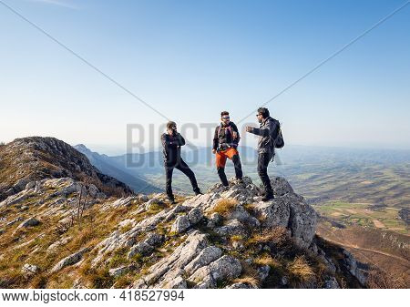 Traveling outdoor hiking in nature.Traveling in nature. Man hikers outdoor in nature. Nature. Hikers. Hiking. Nature and beautiful mountain view. man hikers celebrating success on mountain cliff in nature.