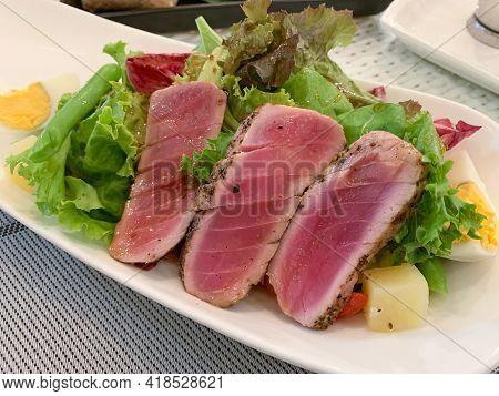Healthy Seared Ahi Tuna Salad On White Dish