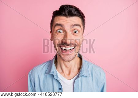 Close-up Portrait Of Nice Cheerful Guy Incredible News Reaction Isolated Over Pink Pastel Color Back