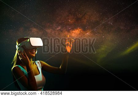 Asian Woman Wearing Virtual Reality Headset To Look At Visual Milky Way In Night Sky, New Experience