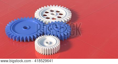 Four Plastic Gears Isolated On Red Background. 3D Illustration