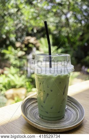 Iced Green Tea Drink In Disposable Take Away Cup, Stock Photo