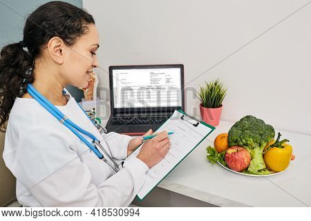 Nutritionist Creates Personalized Meal Plan For Her Patient. Vegetables And Fruits For A Healthy Die