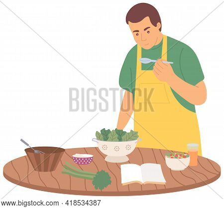 Man Is Studying Culinary By Himself In Kitchen. Male Character Preparing Vegetarian Salad Using Reci