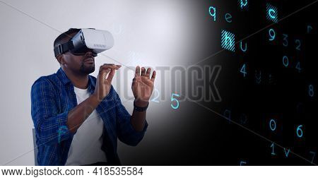 Composition of letters processing over man wearing vr headset and touching virtual screen. global connection, virtual reality and technology concept digitally generated image.