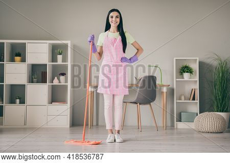 Full Length Body Size View Of Lovely Cheerful Content Long-haired Girl Maid Cleansing Floor Cleanup