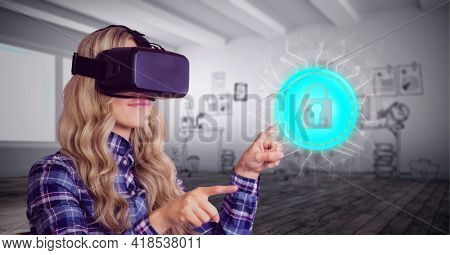 Composition of online security padlock icon over woman wearing vr headset touching screen. global connection, virtual reality and technology concept digitally generated image.
