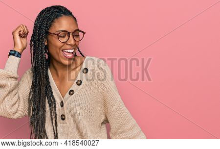 African american woman wearing casual clothes dancing happy and cheerful, smiling moving casual and confident listening to music