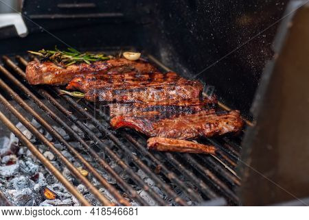 Delicious Grilled Meat. Grilling Steaks On Flaming Grill.
