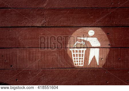 Garbage Symbol, Recycle Bin Icon, Logo On Wood Background. Garbage Place Designation. Environmental