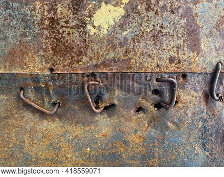 Rusty Metal Wall, Rusty Crooked Nails, Old. It Is Important To Paint The Wall. Nails Are Driven Into