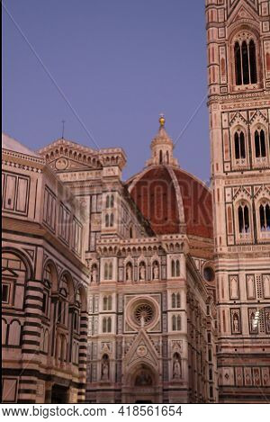 View at dome of Brunelleschi and Giotto bell in Florence by evening