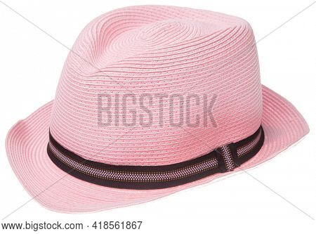 Pink summer panama hat with black ribbon isolated on white background