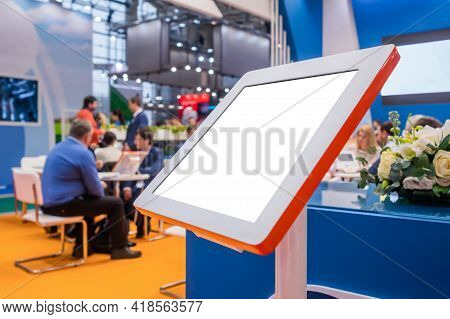 Electronic Multimedia Tablet Kiosk With Blank White Display At Exhibition, Trade Show, Conference -