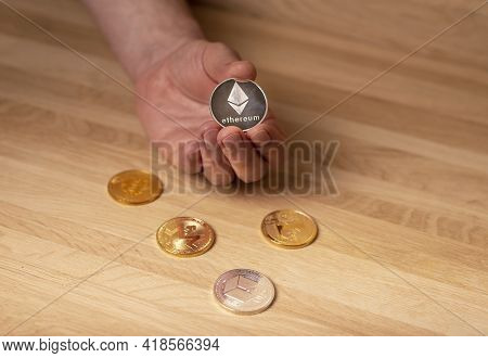 Silver Etherium Coin In Male Hand. Cryptocurrency Concept.