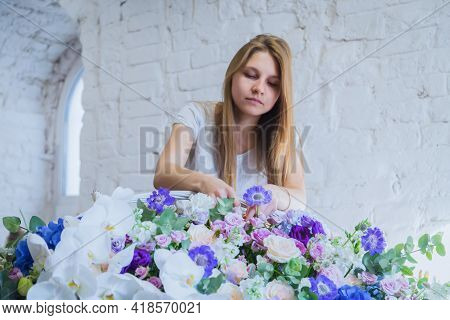 Portrait Of Professional Woman Floral Artist, Florist Making Large Floral Basket With Flowers At Wor