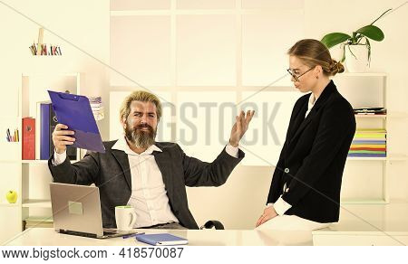 Successful Business. Business Couple Working. Couple In Office. Distribute Obligations And Organize