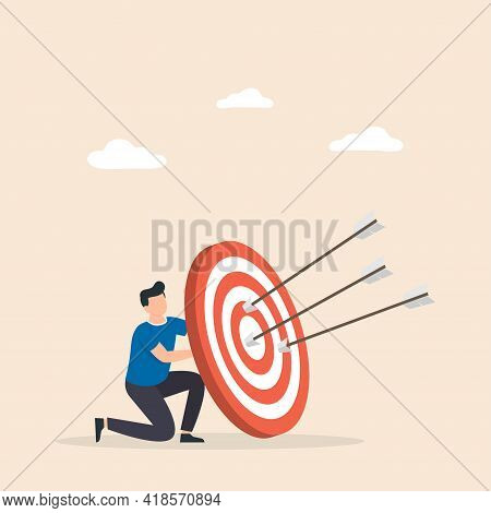 Man Hold Big Target With Arrow In Bullseye. Purpose In Business, Success, Goal Achievement, Victory.