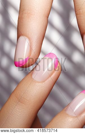 Hands With Bright Pink French Manicure. Nails Art Design. Close-up Of Hands With Trendy Neon Nails O