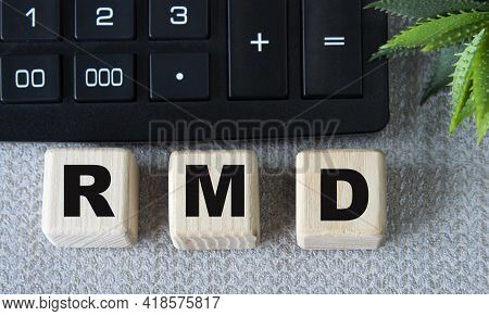 Rmd (required Minimum Distribution) - Acronym On Wooden Cubes On A Gray Background With A Calculator