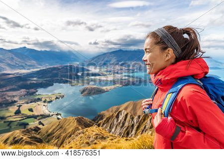 Lifestyle Travel Hiking concept with woman hiker living active aspirational life on outdoor adventure vacation traveling hiking at Roys Peak, South Island, New Zealand.