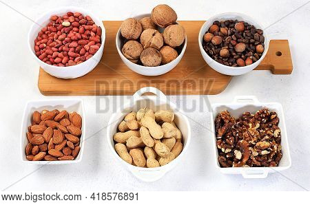 Assortment Of Different Nuts, Healthy Natural Food Concept, Almonds, Pecans, Pistachios, Cashews, Wa