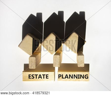 Estate Planning Symbol. Wooden Blocks With Words 'estate Planning'. Houses Created By Shadows From W