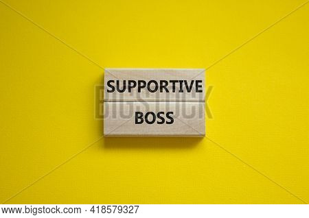 Supportive Boss Symbol. Wooden Blocks With Words 'supportive Boss' On Beautiful Yellow Background. B