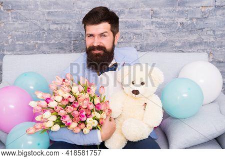 Macho Ready Romantic Date. Man Wear Blue Tuxedo Bow Tie Hold Flowers Bouquet. Romantic Man With Flow