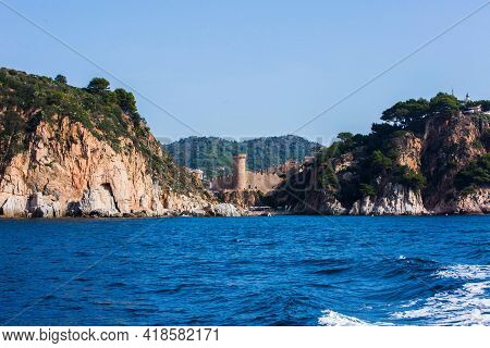 Tossa De Mar, Spain, May 1, 2020 - View From Sea Of Ancient Fortress In Tossa De Mar On Costa Brava