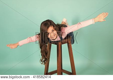 Follow Me. Girl Kid Cheerful Imitate Plane Flying. Kid Play Game Fly As Plane With Wide Apart Hands.