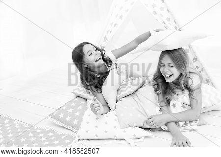 Pajamas Party For Kids. Girls Having Fun Tipi House. Girlish Leisure. Sisters Share Gossips Having F