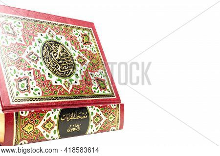 A Picture Of Holy Quran On Isolated White Background. Large Writen Arabic Word Mentioned Holy Quran