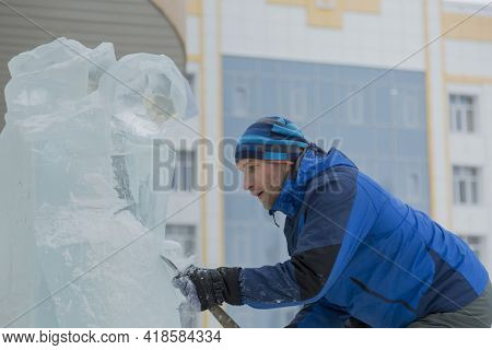 Portrait Of A Sculptor At Work On A Figure