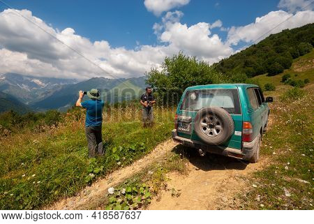 Georgia, Racha - August 13, 2015: A Group Of Travelers Enjoys The Amazing View Of The Mountains.