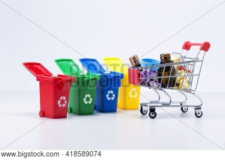 Plastic Containers For Garbage Of Different Types And Trolley With Rubbish. Waste Management Concept