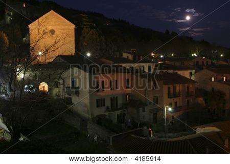Cloudy Full Moon Over Cortona, Italy
