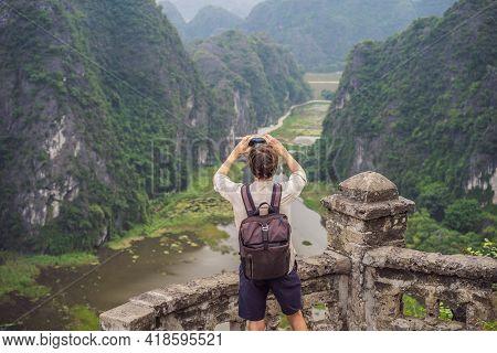 Man Tourist In Boat On The Lake Tam Coc, Ninh Binh, Viet Nam. Its Is Unesco World Heritage Site, Ren