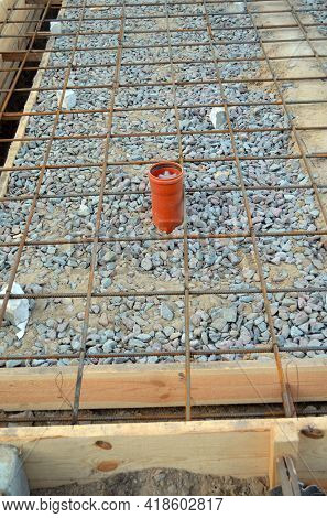 Timber formwork with metal reinforcement for pouring concrete and creating a solid foundation for a building or fence. Construction process.