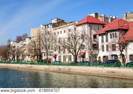 Bucharest, Romania, 13 February 2021 - Landscape With Large Old Trees And Old Buildings Near Dambovi