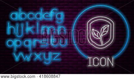 Glowing Neon Line Shield With Leaf Icon Isolated On Brick Wall Background. Eco-friendly Security Shi