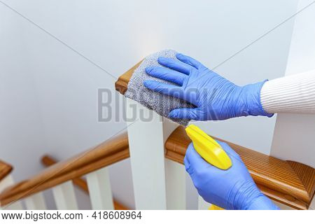 Woman Hands In Gloves Cleaning Stairs Railings With Gray Rag