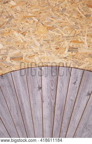 Laminate floor on wood osb background texture. Wooden laminate floor plank with copy space