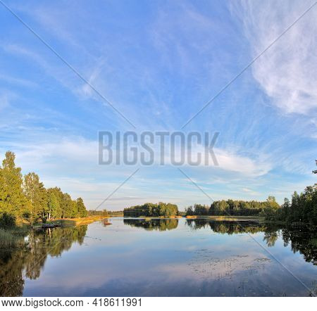 Landscape with blue sky and clouds reflect in lake