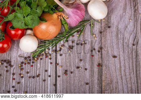 group of bright ripe vegetables om dark brown wood table
