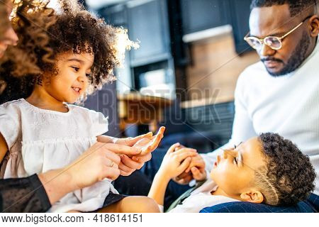 Happy Family With Two Kids Playing At Home Sun Light In Curly Hair