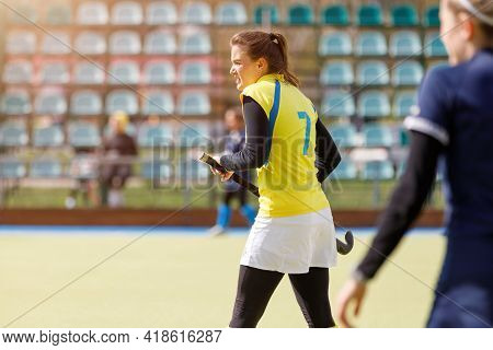 Young Field Hockey Girl Player With Stick At Pitch
